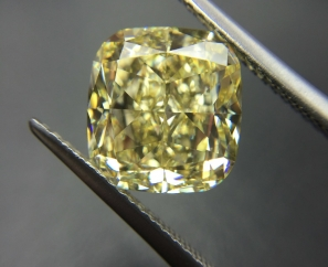 5.44 ct Cushion Modified Brilliant Fancy Yellow IF – Sold