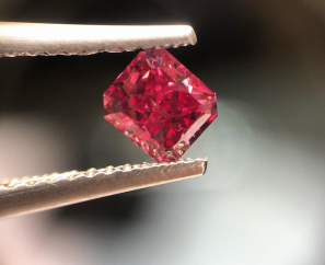 0.61 CT Cornered Rectangular Modified Brilliant Fancy Purplish Red I1 – SOLD