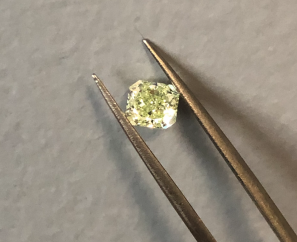 0.92CT CUT-CORNERED FANCY INTENSE YELLOW-GREEN DIAMOND-SOLD